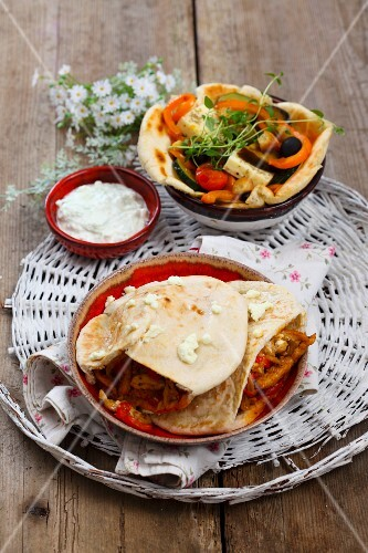 Pita bread with a spicy kebab filling and yoghurt