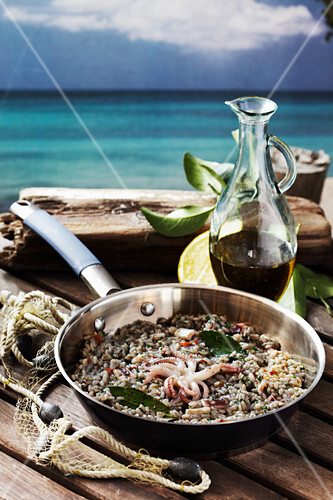 Seafood risotto with bay leaves