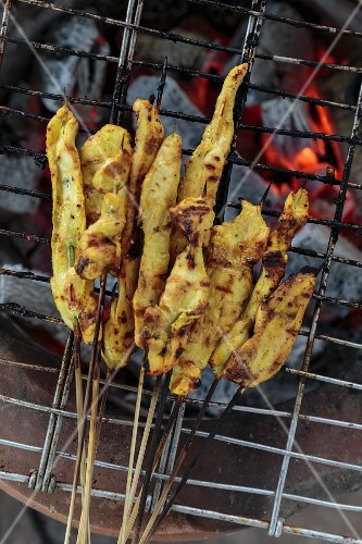 Satay kebabs on a barbecue