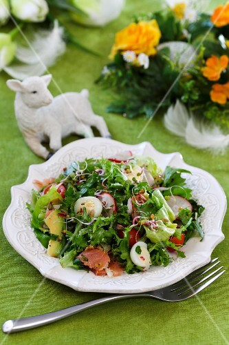 Easter salad with salmon, avocado and quail's eggs