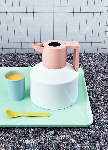 Lemonade and a jug on a tray