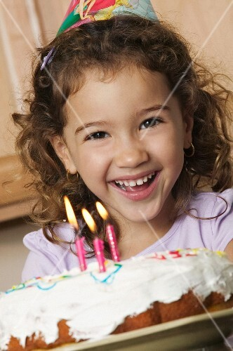 A little girl with a birthday cake