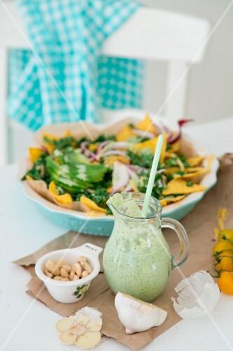 Vegan coriander sour cream with nachos with kale and avocado