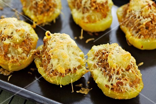 Stuff baked potatoes topped with cheese