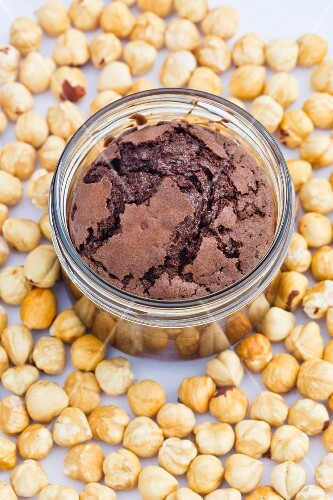 Freshly baked hazelnut and chocolate cake in a glass