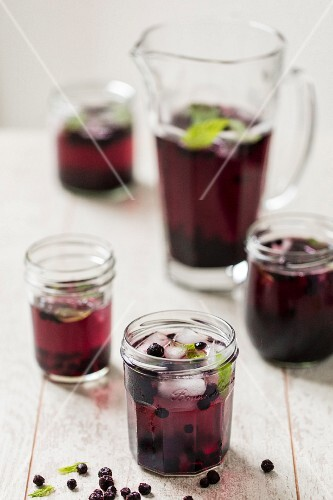 Blueberry punch with ice cubes and mint