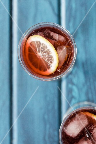 Cocktails with lemon and ice cubes