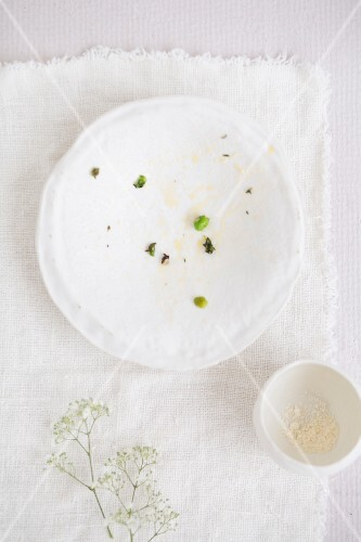 Empty plates and remains of food