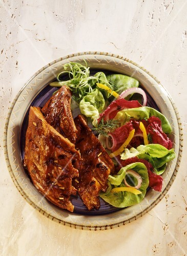 Spare ribs with a colourful salad