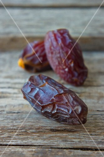 Dried dates on a wooden surface