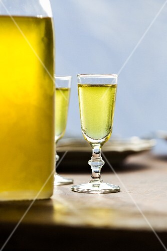 Limoncello (Italian lemon liqueur) in two glasses and a bottle