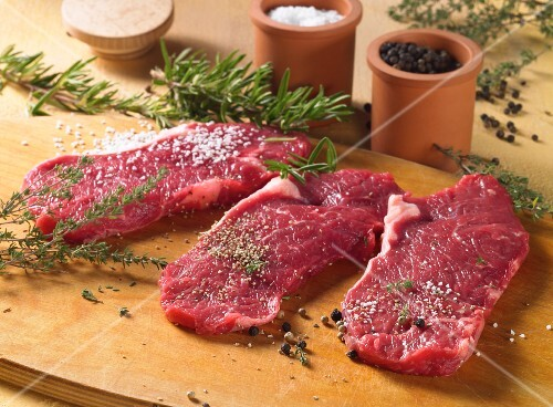Spiced beef steaks with herbs and spices, ready to fry
