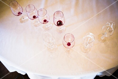 Clean and dirty wine glasses on a table, seen from above