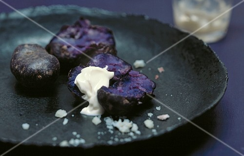 Fried purple potatoes with sour cream