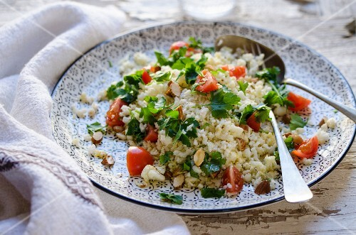 Cauliflower tabbouleh with almonds, cherry tomatoes and parsley