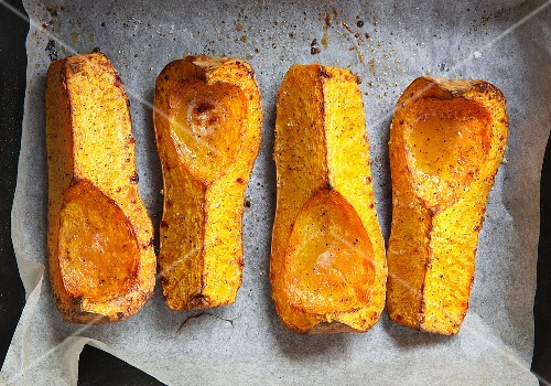 Roasted butternut squash on baking paper (seen from above)