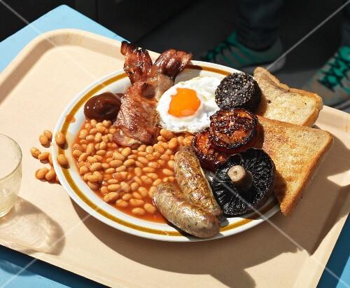 A full English breakfast on a tray