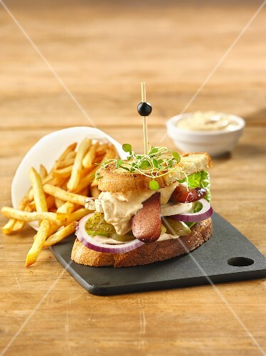 Sandwich with sausages, gherkins and mayonnaise