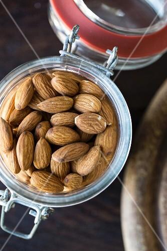 Almonds in a flip-top jar