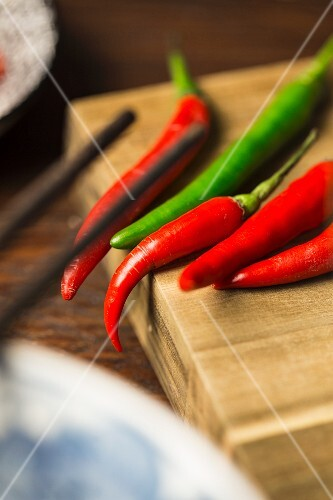 Fresh chilli peppers as ingredients with beef soup with anise and cinnamon (Vietnam)