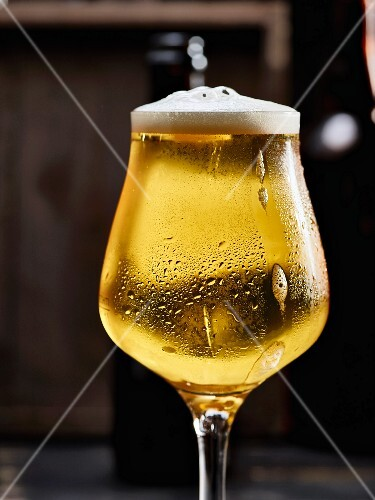 A glass of cold beer with condensation