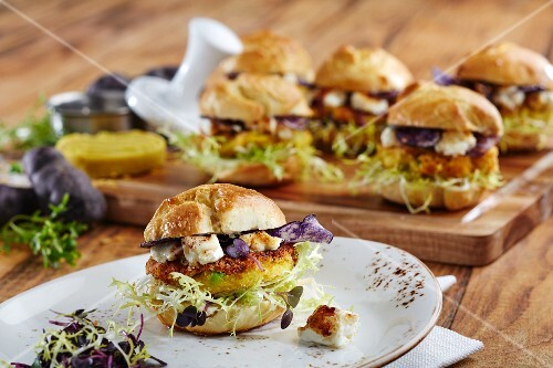 Mini veggie burgers with polenta patties, feta cheese and various types of lettuce