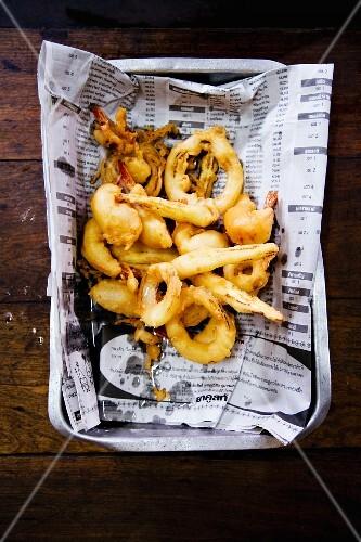 Seafood tempura on a piece of newspaper