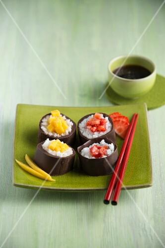 Chocolate sushi with mango and strawberries