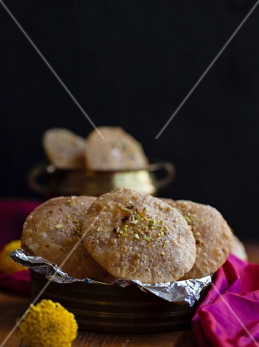 Stuffed unleavened bread with coconut and jaggery (Asia)