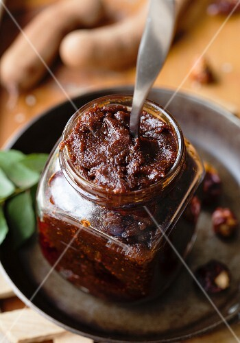 Tamarind chutney and a jar with a spoon