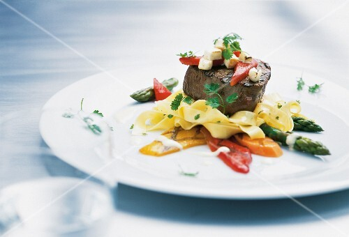 Beef fillet steak with tagliatelle, asparagus and pepper