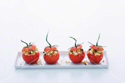 Tomatoes filled with couscous salad