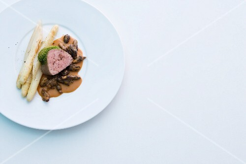 Veal fillet with a wild garlic crust, asparagus and a morel mushroom sauce