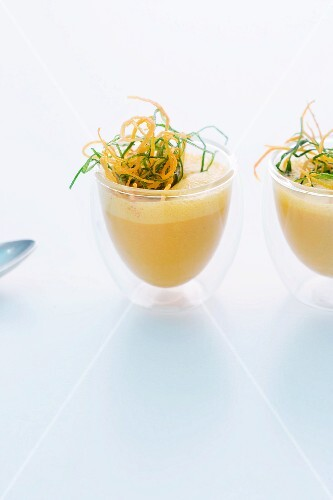 Carrot soup with ginger and vegetable straw