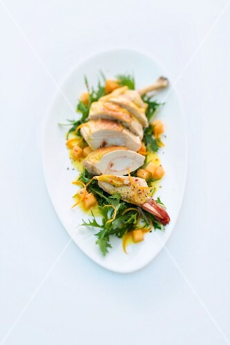 Corn-fed chicken filled with prawns on a bed of rocket with an orange and melon dressing