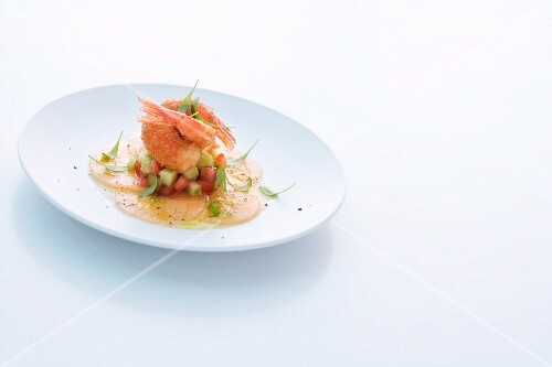 King prawns on a vegetable salad and melon carpaccio