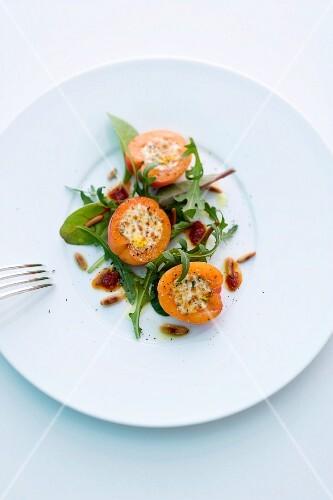 Stuffed ricotta apricots on a mixed leaf salad