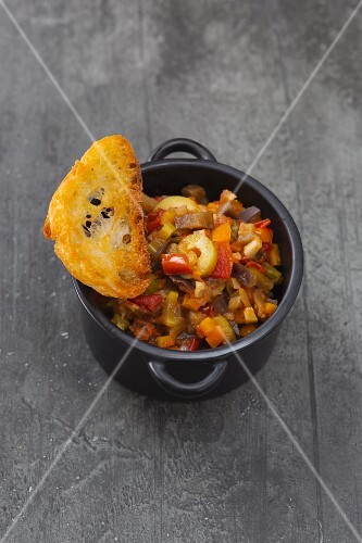 Caponata with grilled white bread (Sicily, Italy)