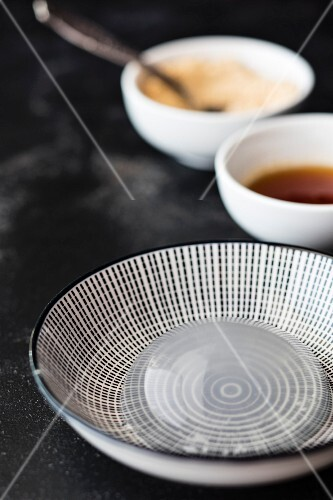 Mizu Shingen Mochi (Japanese raindrop cake) on a black-and-white plate