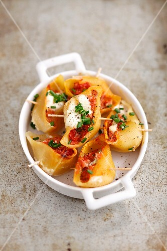 Baked conchiglie stuffed with pork with sour cream