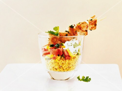 Chicken kebabs on a couscous salad served in a glass