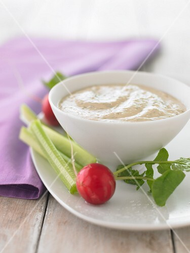 A tofu and dill dip with radishes and celery