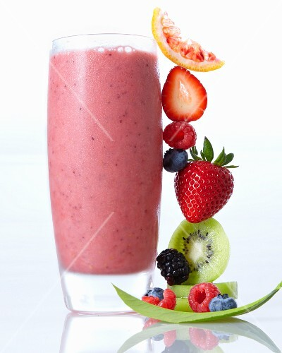 A smoothie and a stack of fruit
