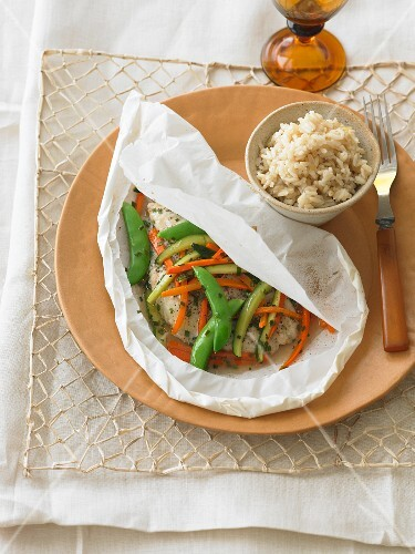 Steamed catfish with vegetables in parchment paper