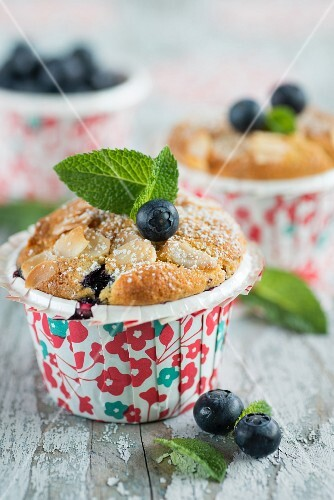 Blueberry muffins with flaked almonds and mint