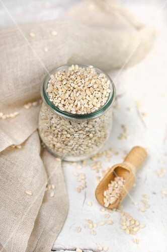 Barley in a jar and on a wooden scoop