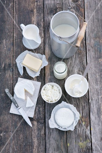 An arrangement of various dairy products on a wooden surface
