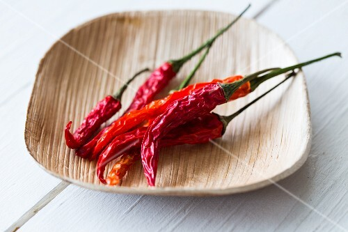 Dried chilli peppers in a bamboo bowl