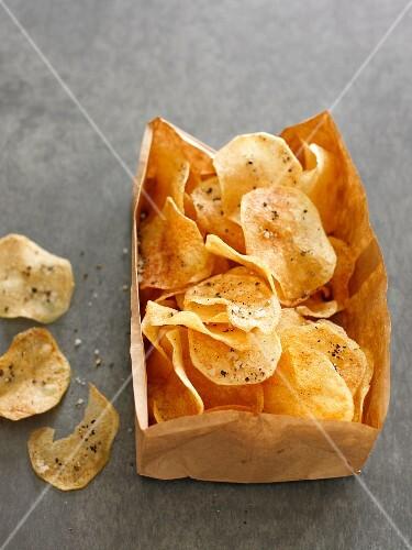 Potato crisps in a paper bag