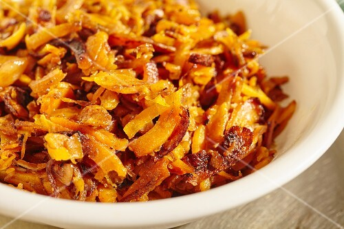 Grated butternut squash fried in olive oil with garlic and herbs